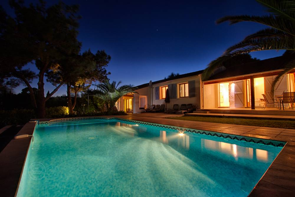 Twilight pool and house