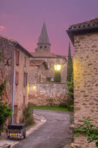 rose and pink dawn sky with church and village scene
