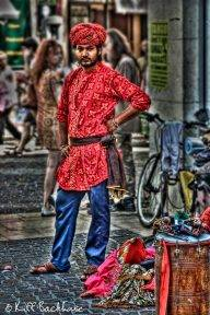 A street performer waiting his turn ...